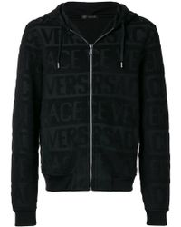 Versace - All Over Logo Hoodie - Lyst