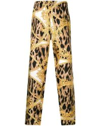 Versace - Leopard Baroque Print Trousers - Lyst