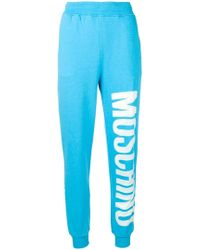 Moschino - Logo Print Track Trousers - Lyst