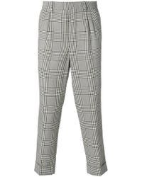 AMI - Pleated Carrot Fit Trousers - Lyst