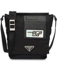 61b4d4a51e1a Prada Comic Logo-print Shoulder Bag in Black for Men - Lyst