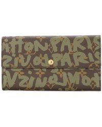 b9037f16a Louis Vuitton - Tarjetero con monograma de grafiti - Lyst
