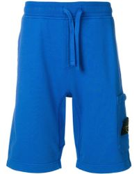 Stone Island - Pantalones cortos de deporte - Lyst