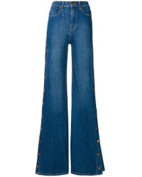 Alice + Olivia - Buttoned Side Flared Jeans - Lyst