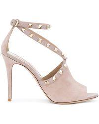 1311e8df7075 Lyst - Valentino  Rockstud  Sandals in Natural