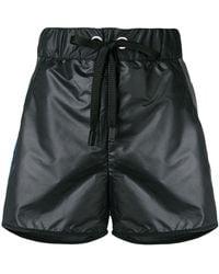 NO KA 'OI - Patent running shorts - Lyst