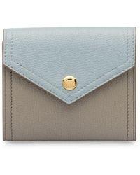 c2131c832329 Lyst - Miu Miu Madras Leather Continental Wallet in Black