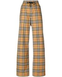 Burberry - Flared Checked Trousers - Lyst