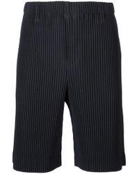Homme Plissé Issey Miyake - Shorts plisados ajustados de canalé - Lyst
