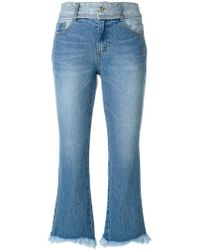 SJYP - Cropped Flared Jeans - Lyst