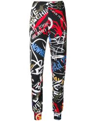Love Moschino - Graffiti Print Leggings - Lyst