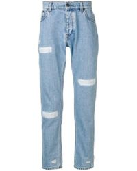 MSGM - Tapered-Jeans mit Distressed-Details - Lyst