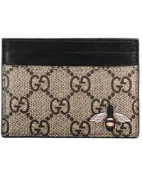 75c25d96fc7 Lyst - Gucci Gg Supreme Bee Bifold Wallet in Natural for Men