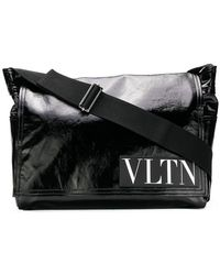 Valentino - Borsa messenger Garavani VLTN media - Lyst
