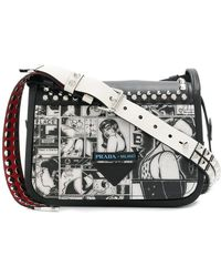 2cde4f0abec9 Lyst - Prada Cartoon Printed Shoulder Bag in Black