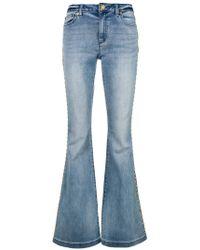 MICHAEL Michael Kors - Studded Flared Jeans - Lyst