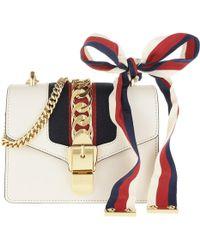2bc5cde0753 Gucci Sylvie Flame Leather Shoulder Bag in Orange - Lyst