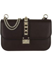 Valentino - Rockstud Lock Crossbody Bag Medium Leather Deep Rubin - Lyst