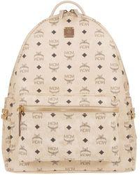 MCM - Medium Stark Side Stud Coated Canvas Backpack - Lyst