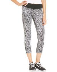 Nike Epic Run Printed Dri-fit Capri Leggings - Lyst