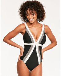 Miraclesuit - Stripe Spectra Trilogy Soft Cup Firm Control Swimsuit - Lyst