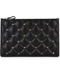11cac8019c Lyst - Valentino Garavani Candystud Clutch in Black
