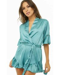 a5fc7cd9bb5025 Lyst - Forever 21 Strapless Flounce Romper in Green