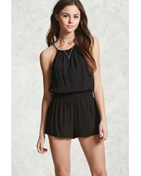 565bffe503cf Lyst - Forever 21 Totally Tribal Print Romper in Black