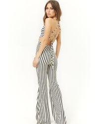 447b6eb9e92 Forever 21 - Cutout Variegated-stripe Jumpsuit - Lyst