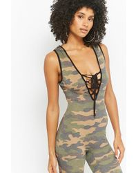 e3e6c8dc522 Lyst - Forever 21 Plus Size Camo Jumpsuit in Green