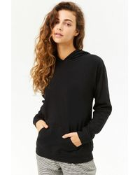 d018ccf870a15f Lyst - Forever 21 Long Sleeve Semi-cropped Tee in Black