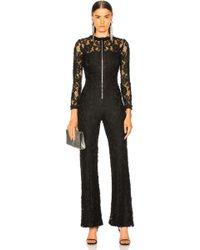 56c7610e5ed Lyst - Alexis Margot Cotton-blend Lace Playsuit in Black