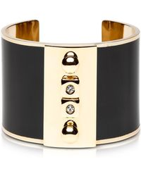 Pluma - Golden Brass And Black Enamel Cuff - Lyst