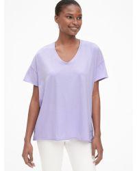 c3477dd40b0142 Lyst - Gap Cold-shoulder Flutter Sleeve Swing T-shirt in Black