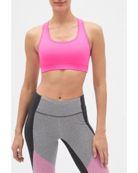 571345c9bfa90 Lyst - Gap Factory Gapfit Medium Impact Racerback Sports Bra in Pink