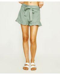 MINKPINK - Teatime Tie Front Frill Skirt Sage - Lyst