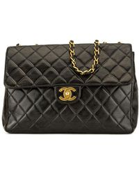 Chanel - Black Quilted Lambskin Leather Classic Jumbo Single Flap Bag - Lyst