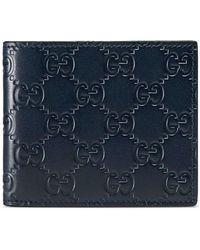 Gucci - Portefeuille en cuir Signature - Lyst