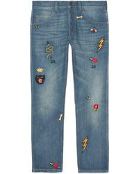 Gucci - Tapered Denim Trousers With Symbols - Lyst