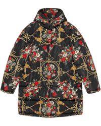 Gucci - Mantella imbottita con fiori e nappine - Lyst