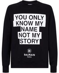 Balmain Printed Slogan Sweatshirt - Black