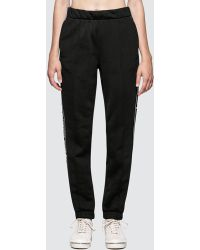 Alexander Wang - Sleek French Terry Pull-on Track Pant With Logo Tape - Lyst