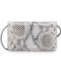 Henri Bendel - West 57th Snake Embossed Xl Smartphone Case Crossbody - Lyst