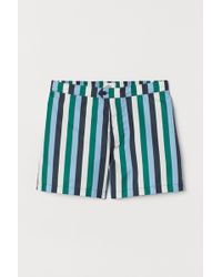 7d61dc31a2 H&M Solid Colour Swim Shorts in Green for Men - Lyst