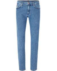 BOSS - Slim-fit Jeans In Mid-blue Stretch Denim - Lyst