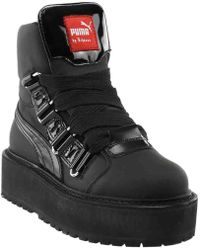 bddaaf7863cca8 Lyst - Puma Leather Wedge Chain Ankle Boot in Black