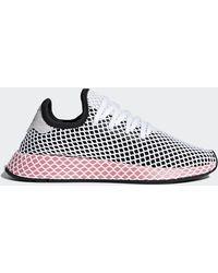 5451bd949f3fc Lyst - adidas Womens Deerupt W in Black