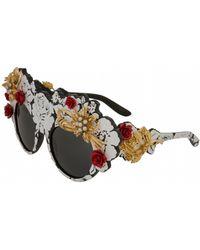 00aaed223ec0 Lyst - Dolce   Gabbana Multi-Print Cat S-Eye Sunglasses in Black