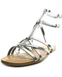 13d16ca67639 Guess - Mannie Women Open Toe Synthetic Silver Gladiator Sandal - Lyst
