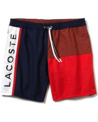 68f8ca1056fdb0 Lyst - Lacoste Colour Block Swim Shorts in Blue for Men